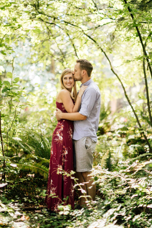 couple laughs in sunset woodland park engagement