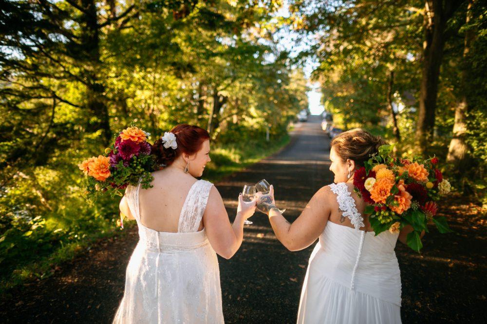 gay couple cheers glasses eastsound wedding