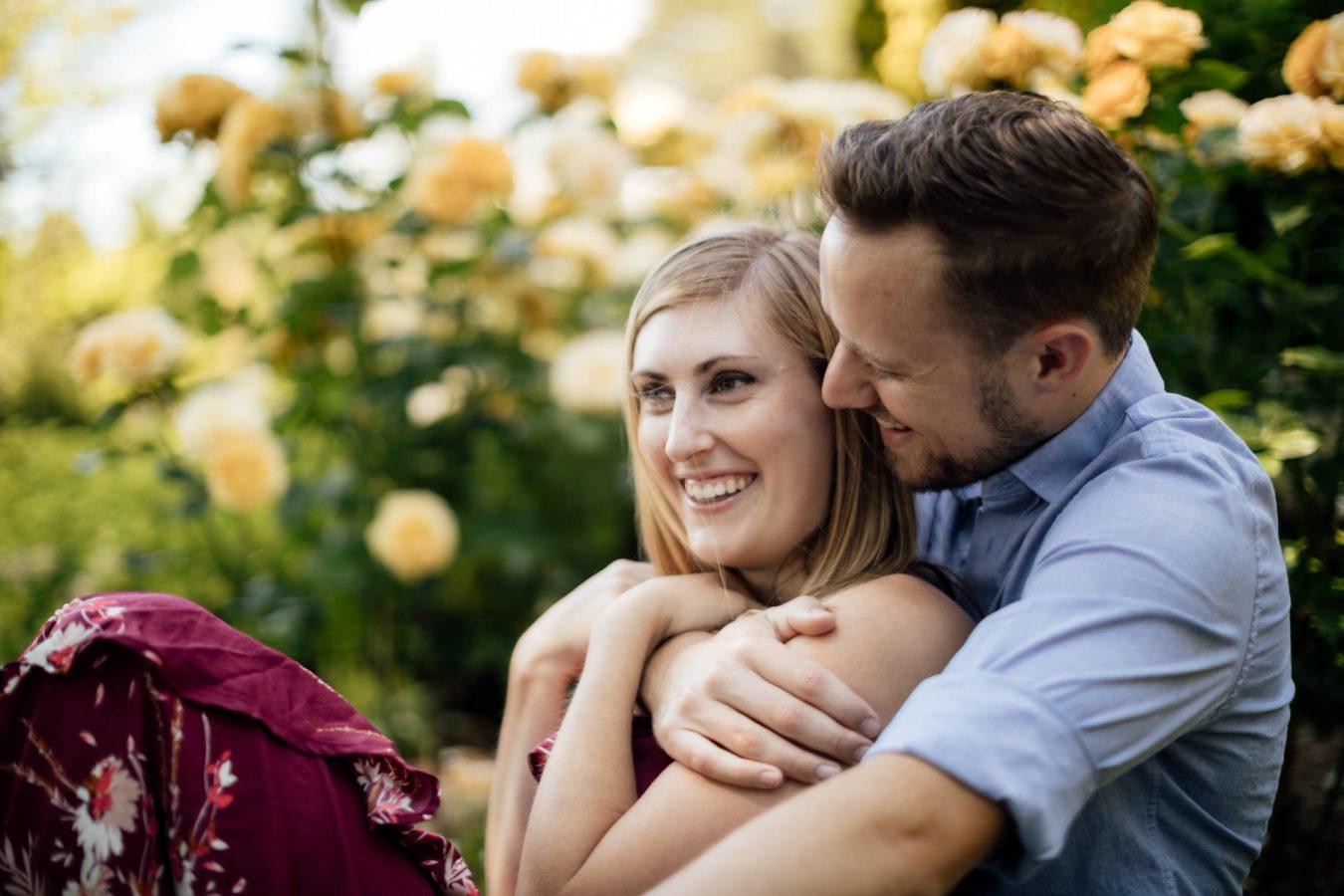 groom holds bride woodland park engagement