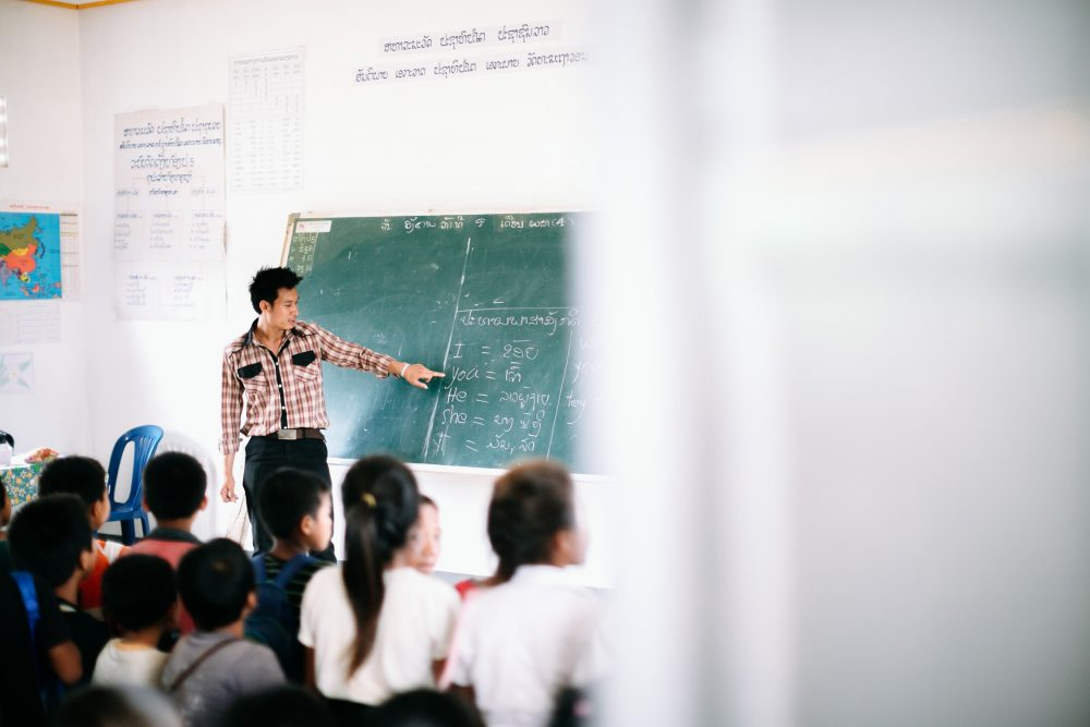 man teaches english in Loas school photo