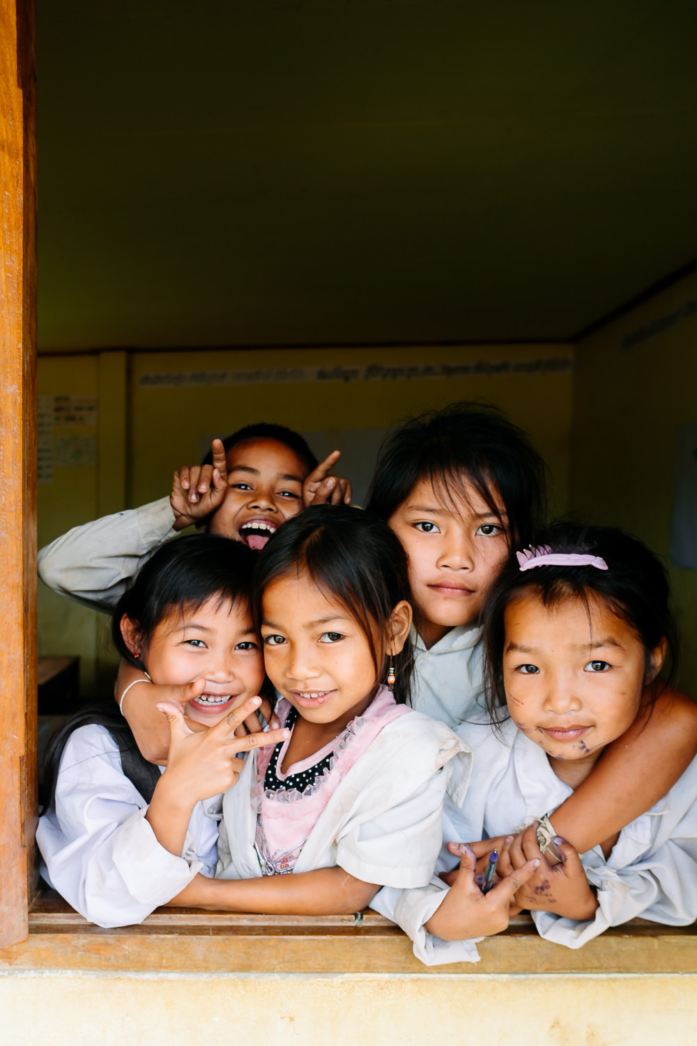 kids smile in laos school photo