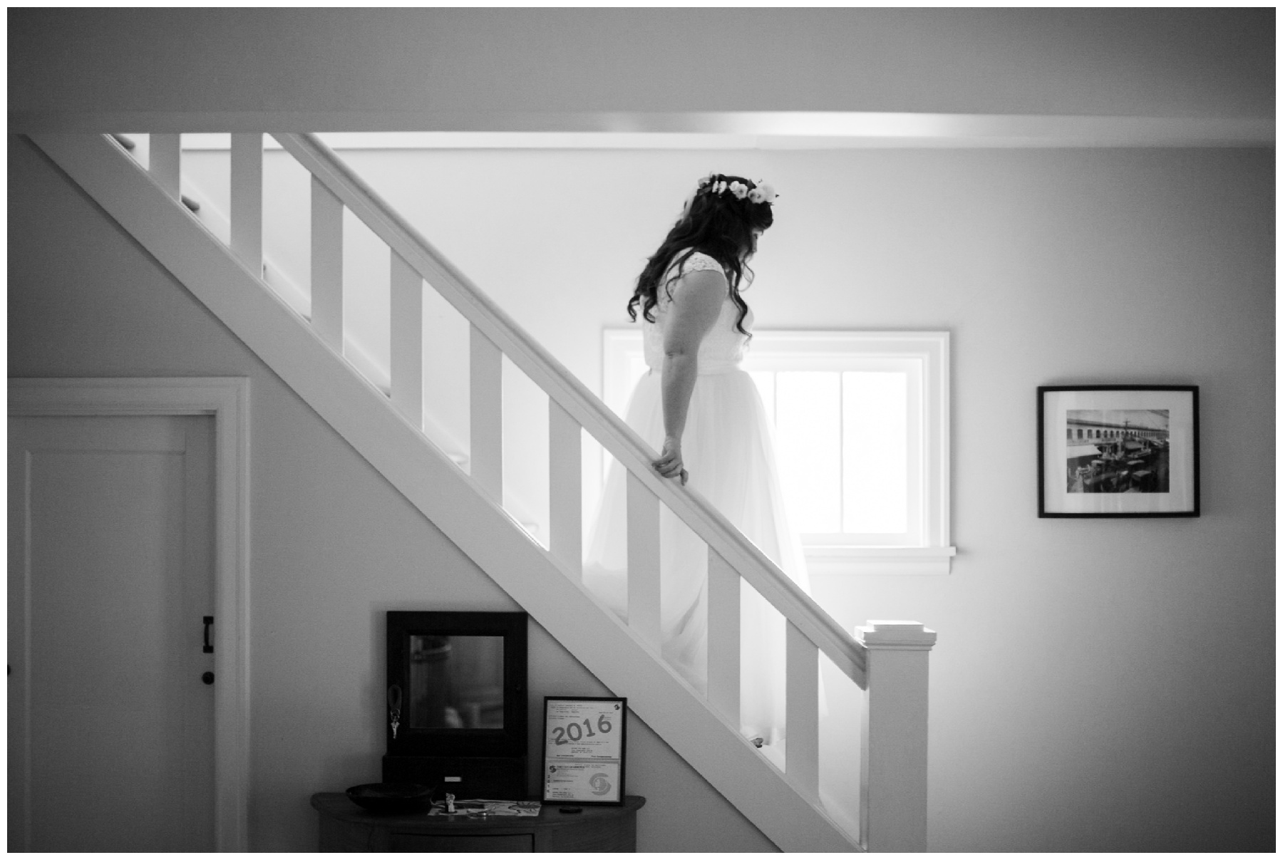 bride walks down stairs seattle wedding