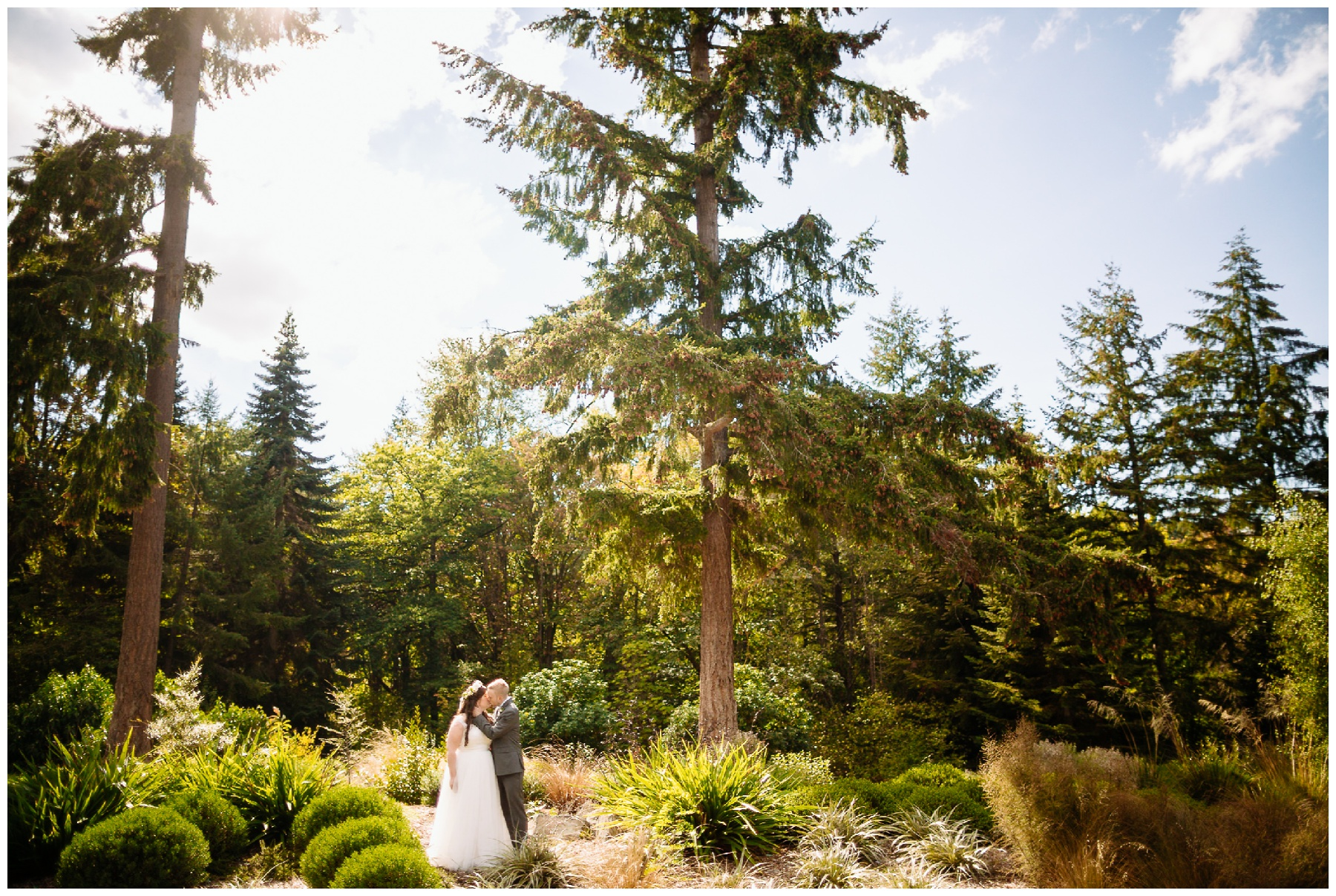bride and groom stand in susnet washington park arboretum wedding