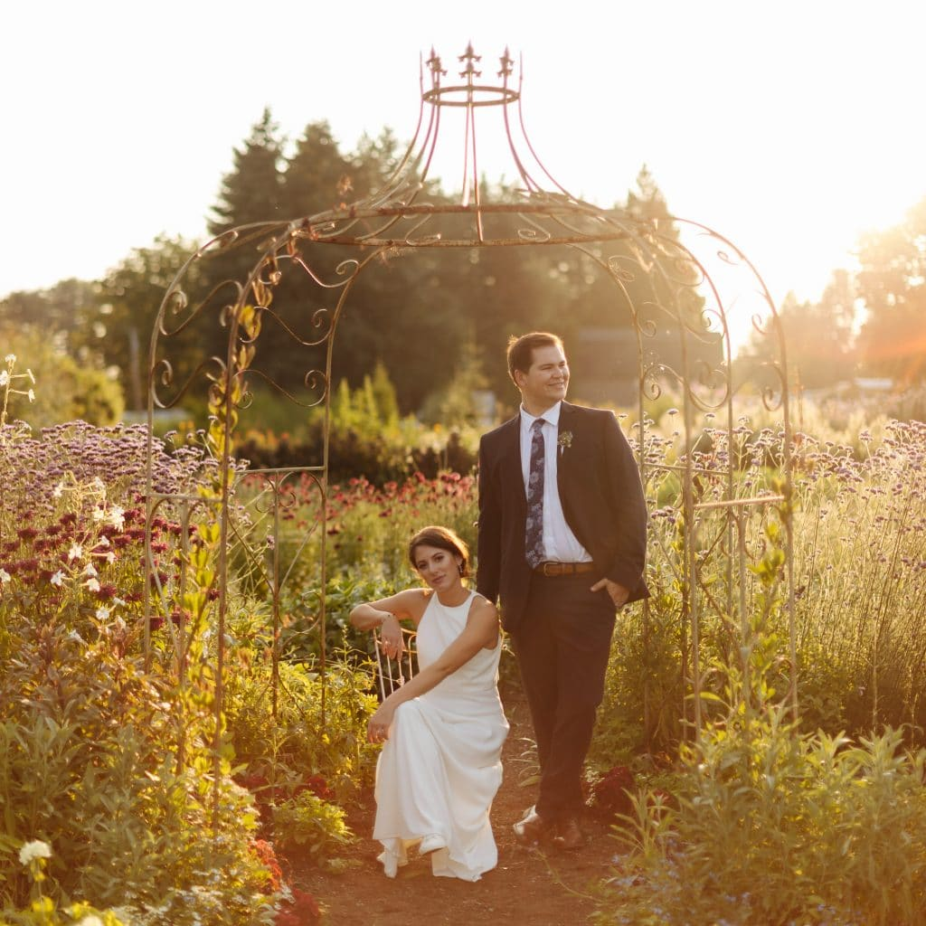 Couple stands together in garden at sunset at Pine Creek Nursery Wedding