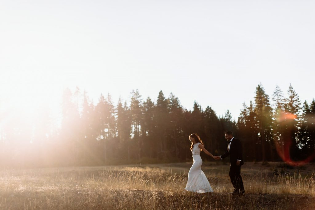 Bride and groom walk through sunset at Swiftwater Cellars wedding in Suncadia, WA