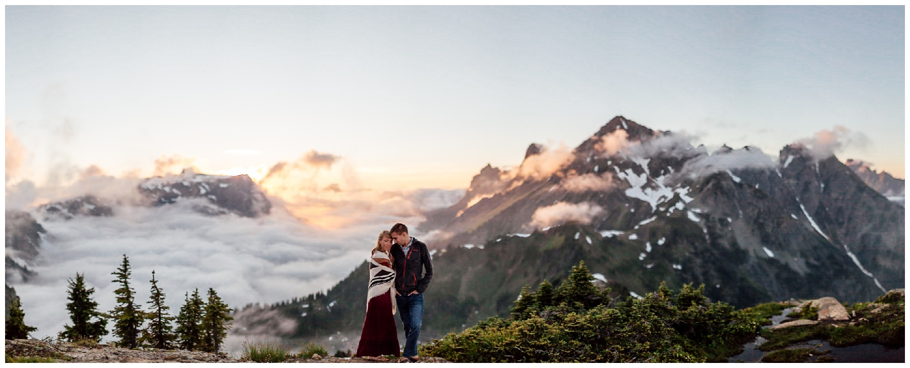 couple stands together at sunset northwest backpacking engagement