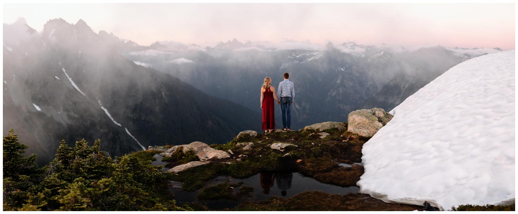 couple stands with reflection PNW backpacking engagement