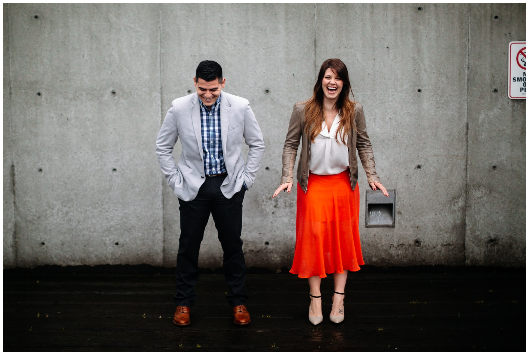 laughing couple seattle waterfront engagement