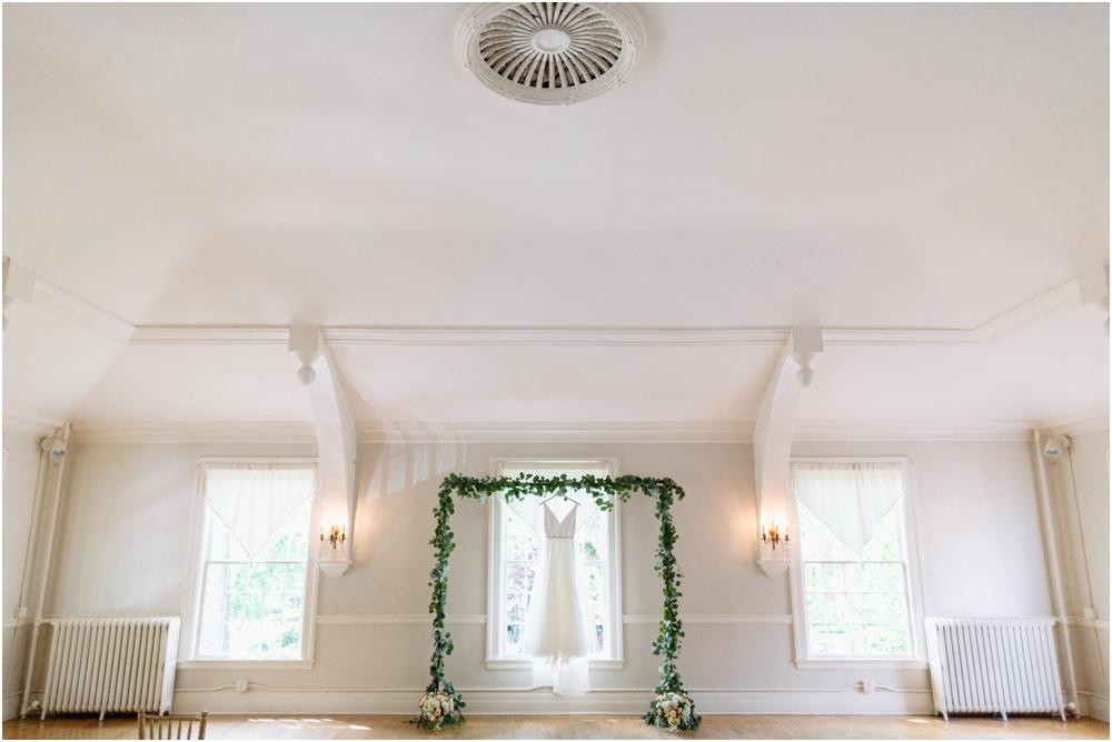 Wedding dress hangs at Rainier Chapter House Wedding