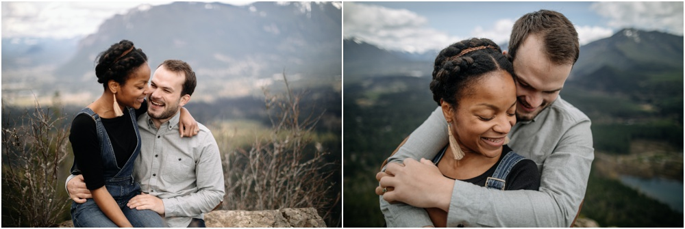 Couple stands together rattlesnake ledge engagement