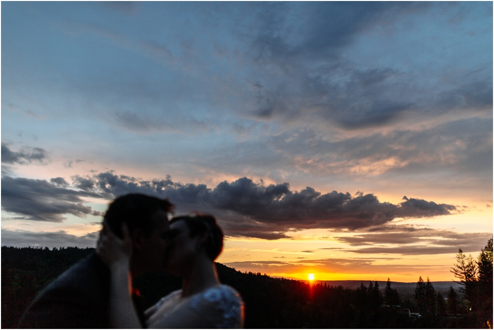 couple kiss in sunset Salish Lodge Wedding