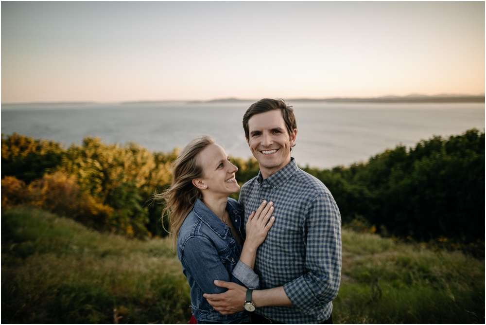 couple laughs together Sunset Discovery Park Engagement
