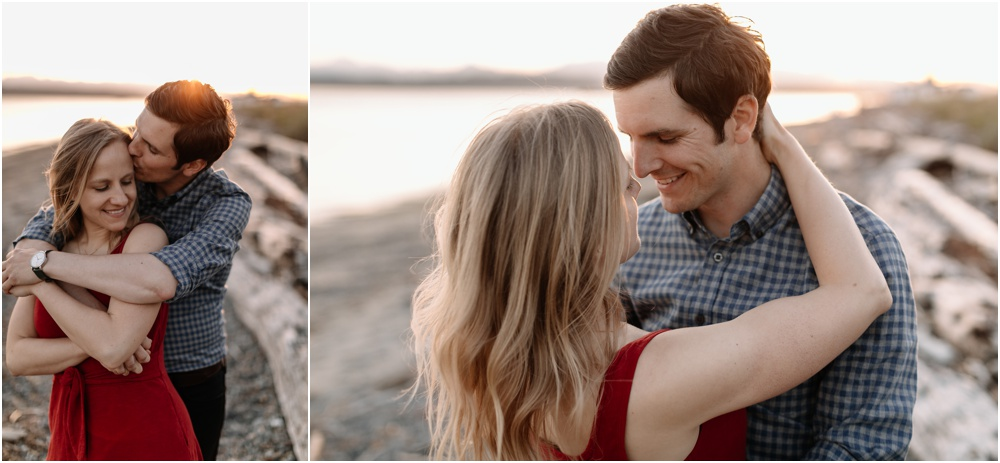couple huddles under blanket Sunset Discovery Park Engagement