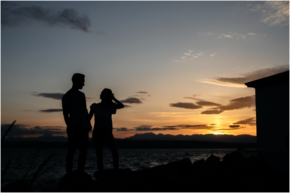 couple holds hands in Sunset Discovery Park Engagement