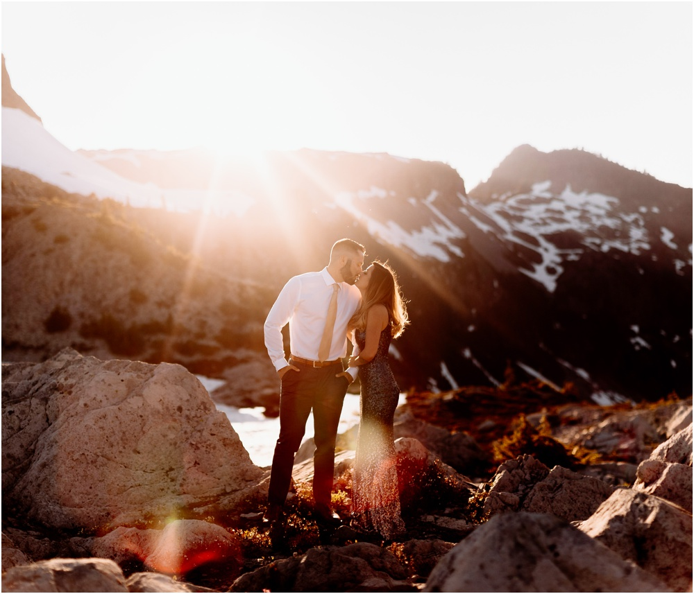 bride and groom kiss in sunset Artist Point hiking engagement