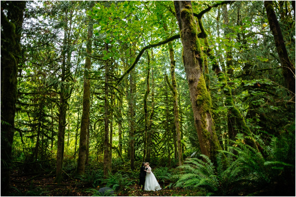 Couple kisses beneath trees Salish Lodge wedding