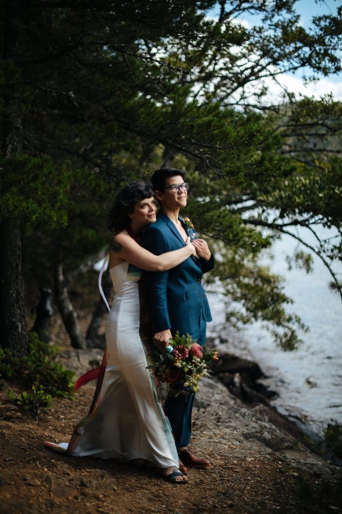 Brides look off into the distance North Cascades Institute Weddi