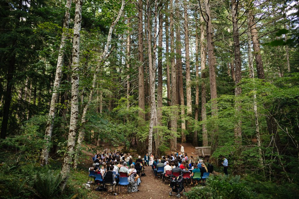 Wedding ceremony under the trees at North Cascades Institute Wed