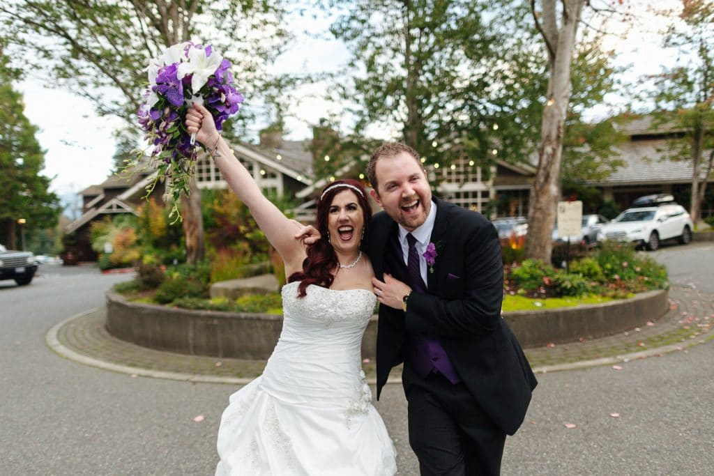 bride and groom celebrate Salish Lodge wedding venue