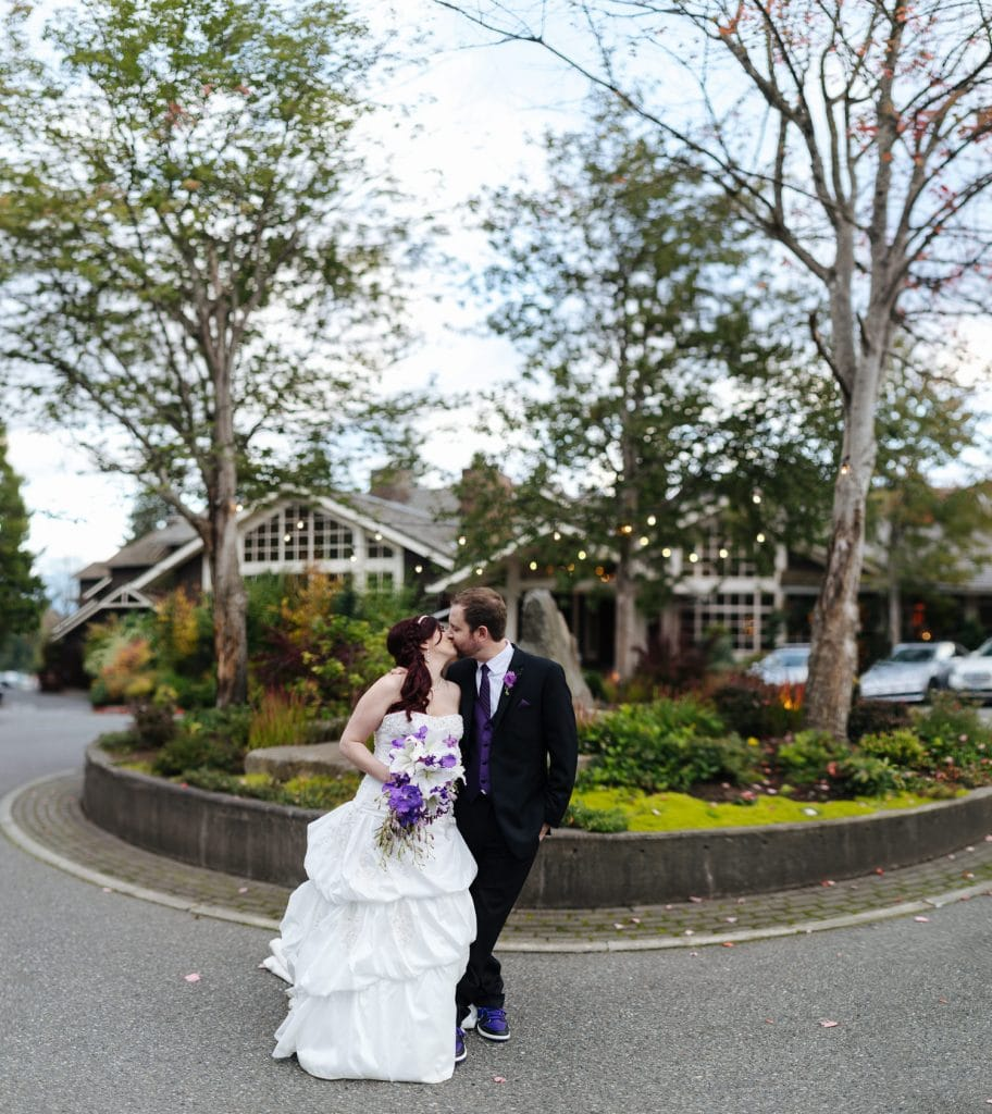bride and groom kiss outside Salish Lodge wedding venue