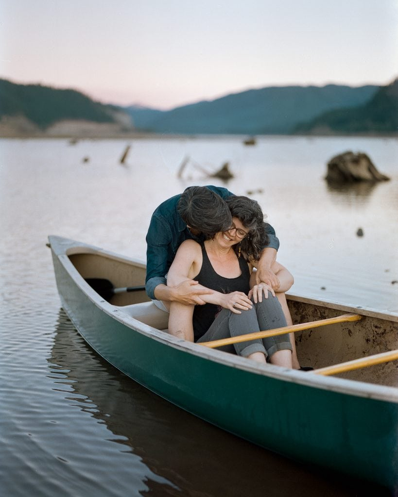 brides kiss in a canoe film photos