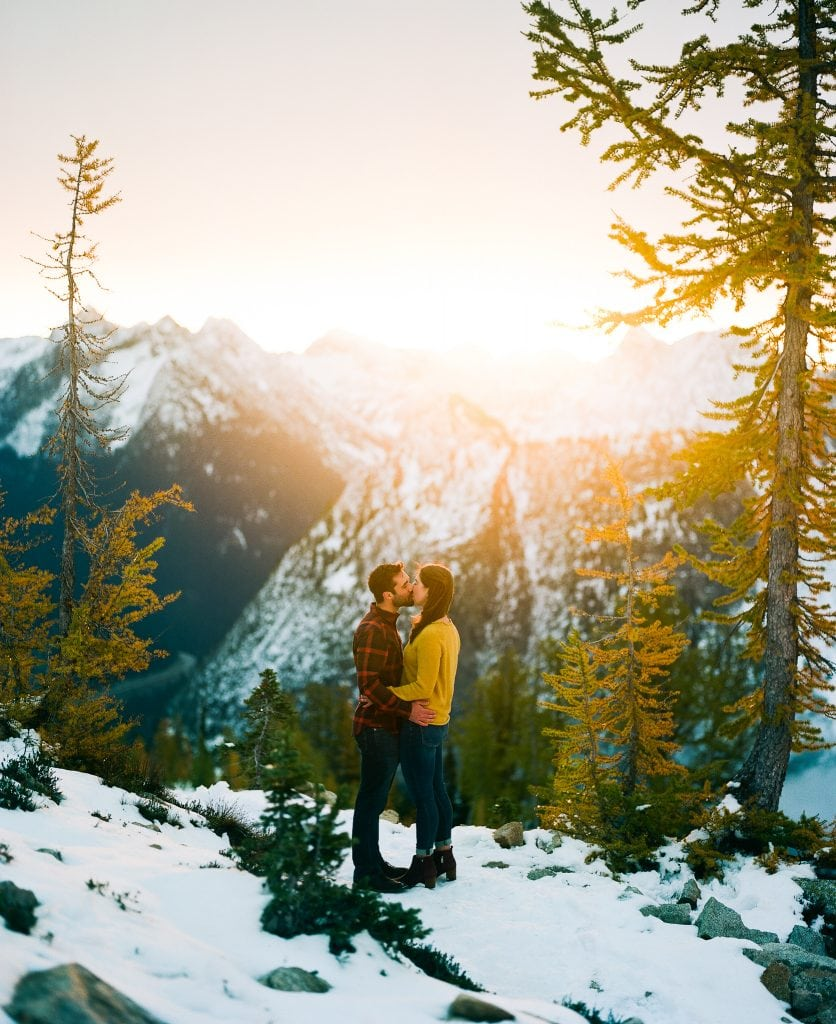 groom and bride kiss in sunrise on film photo