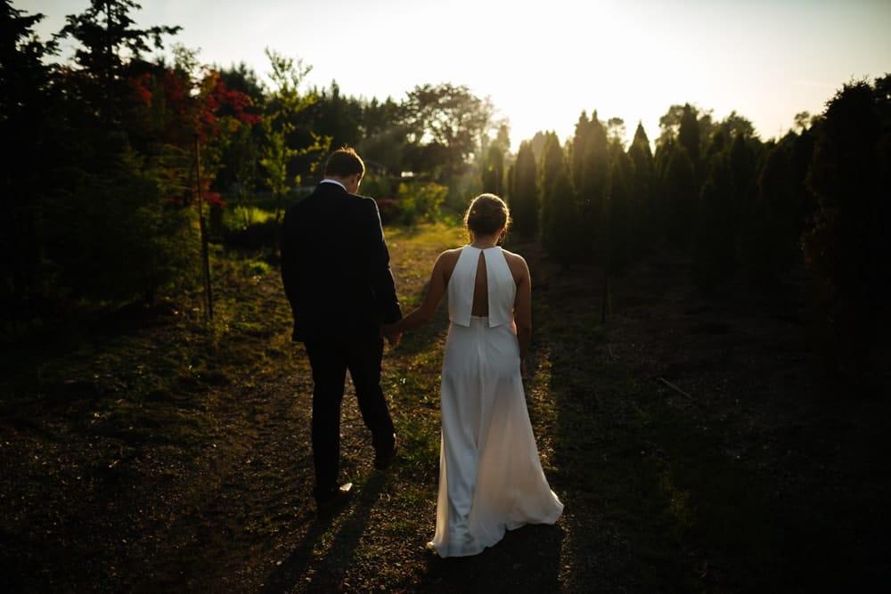 groom and bride walk off into the sunset pine creek nursery wedding