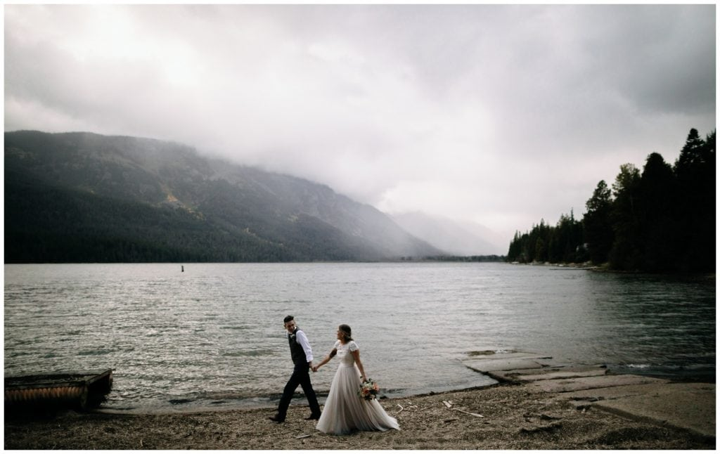 bride and groom walk along Lake Wenatchee brown family homestead wedding