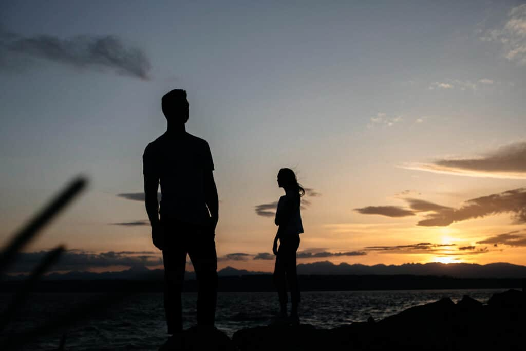 couple stands together in sunset during seattle elopement photos