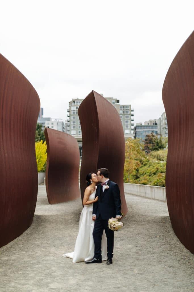 couple kisses during olympic sculpture park elopement