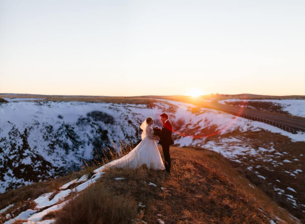 bride and groom in sunset at montana winter wedding