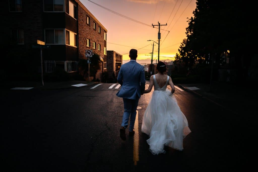 bride and groom run off into sunset during seattle wedding