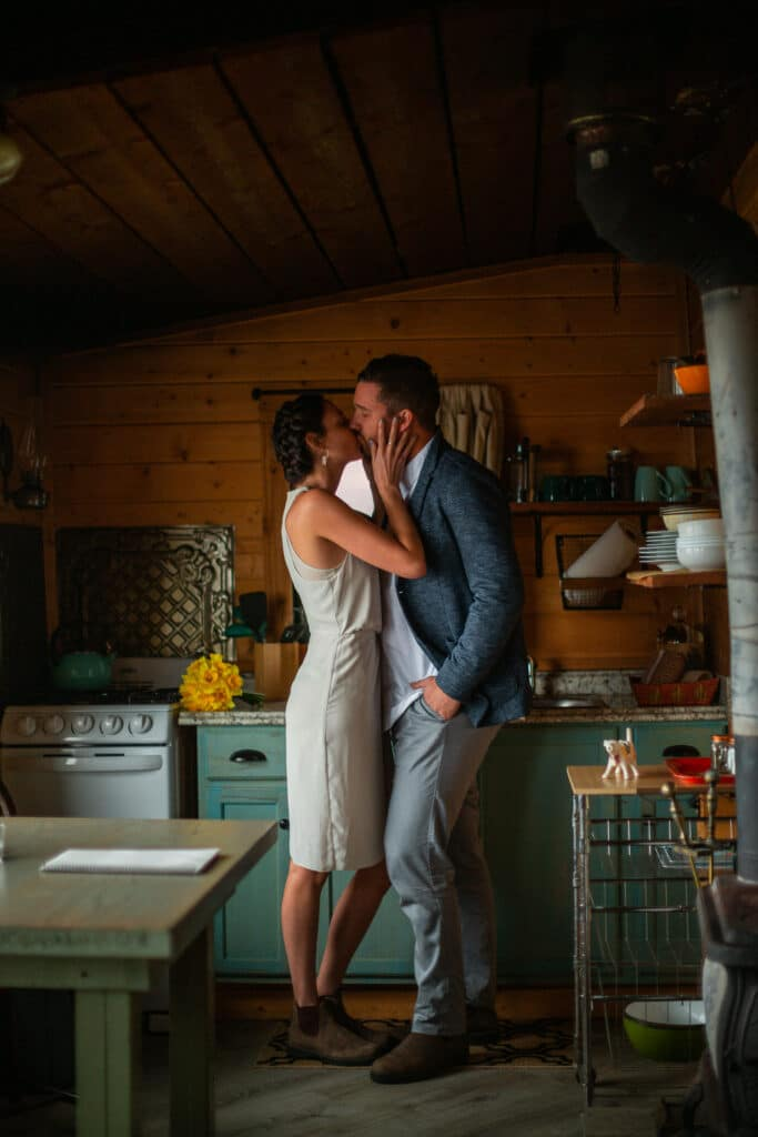 Bride and groom kiss in cabin during olympic national park elopement