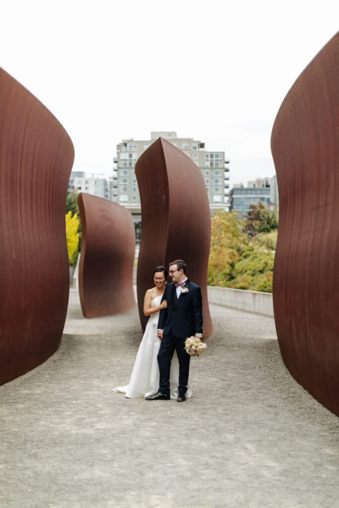 couple poses at olympic sculpture park for seattle elopement photos