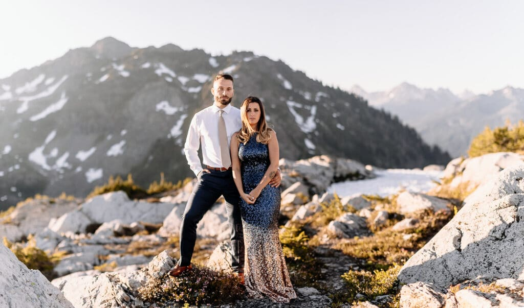 Couple poses in front of mountain during north cascades elopement