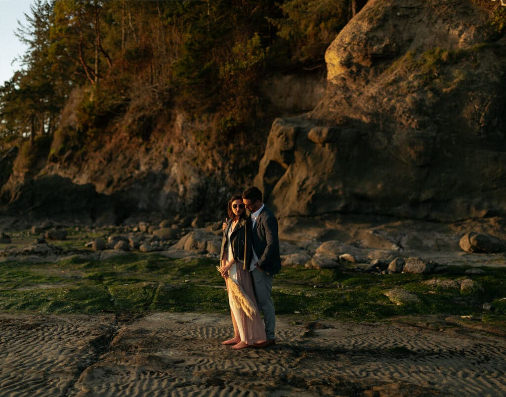 Couple stand together Olympic Coast elopement