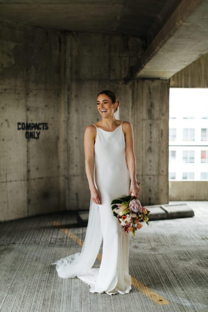 bride laughs during seattle wedding photos
