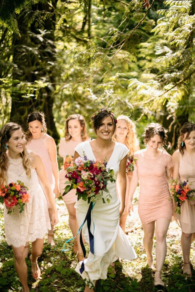 bride walks with bridesmaids during north cascades wedding