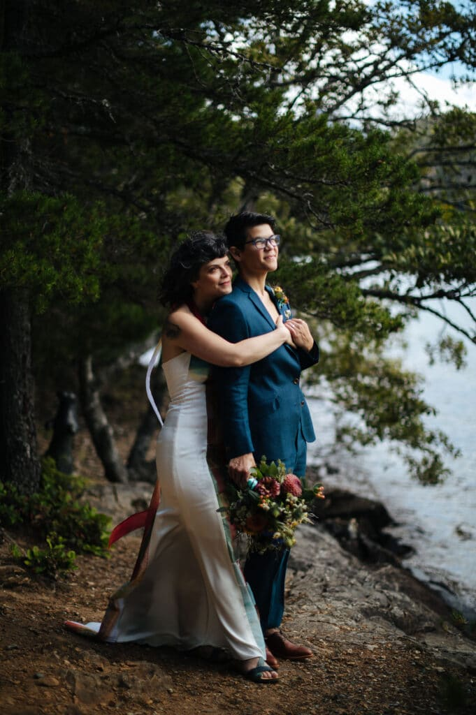 Brides look off into the distance North Cascades Institute Weddi