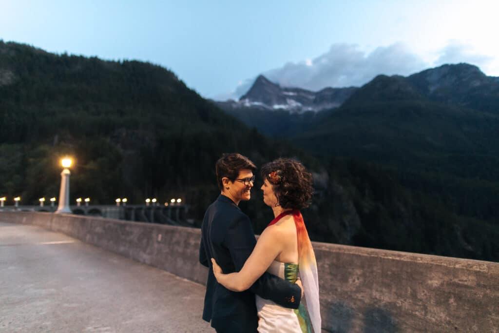 brides smile in sunset on diablo lake dam