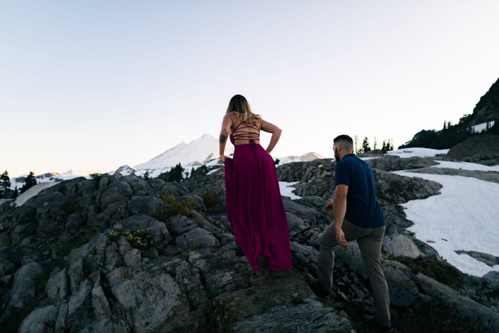 copule climbs up mountain in sunset during north cascades elopement