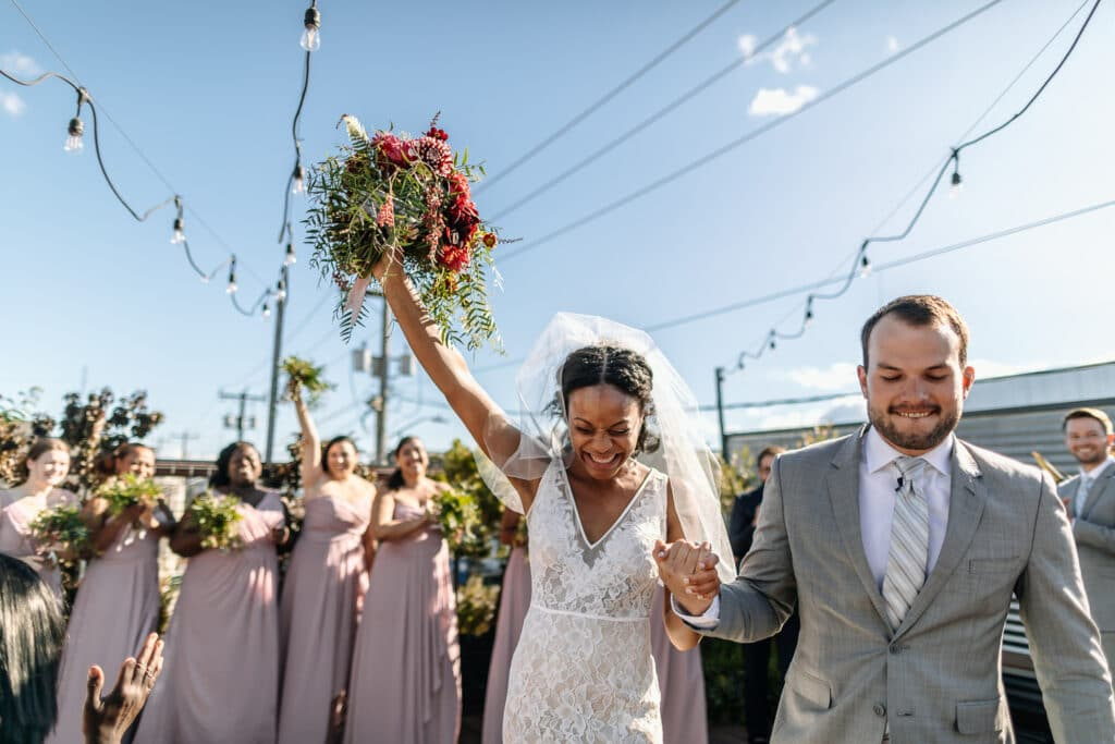 couple celebrates jumping the broom at wedding in seattle