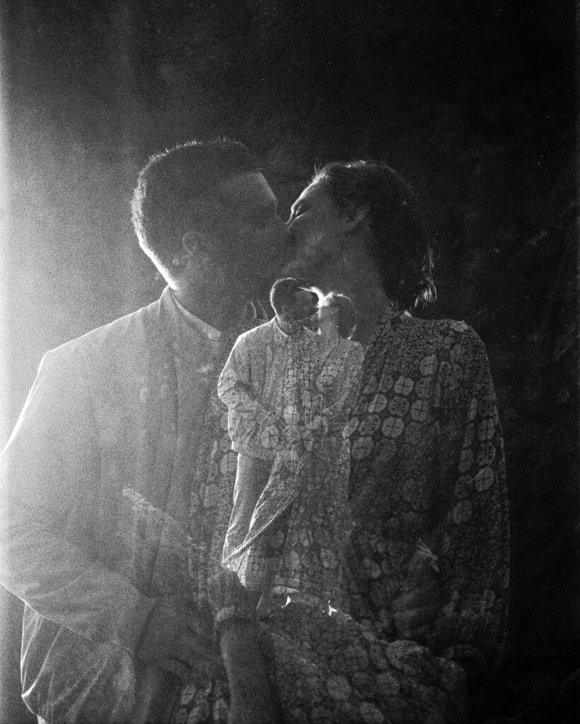 couple kisses double exposure ruby beach elopement in olympic national park