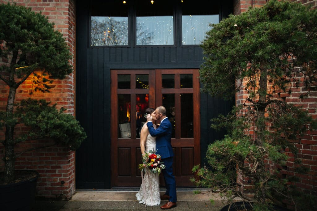 couple kisses outside georgetown ballroom during seattle wedding