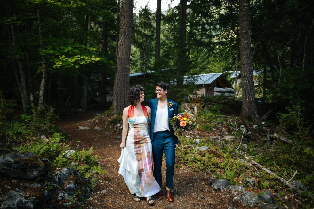 couple laughs while walking during north cascades elopement