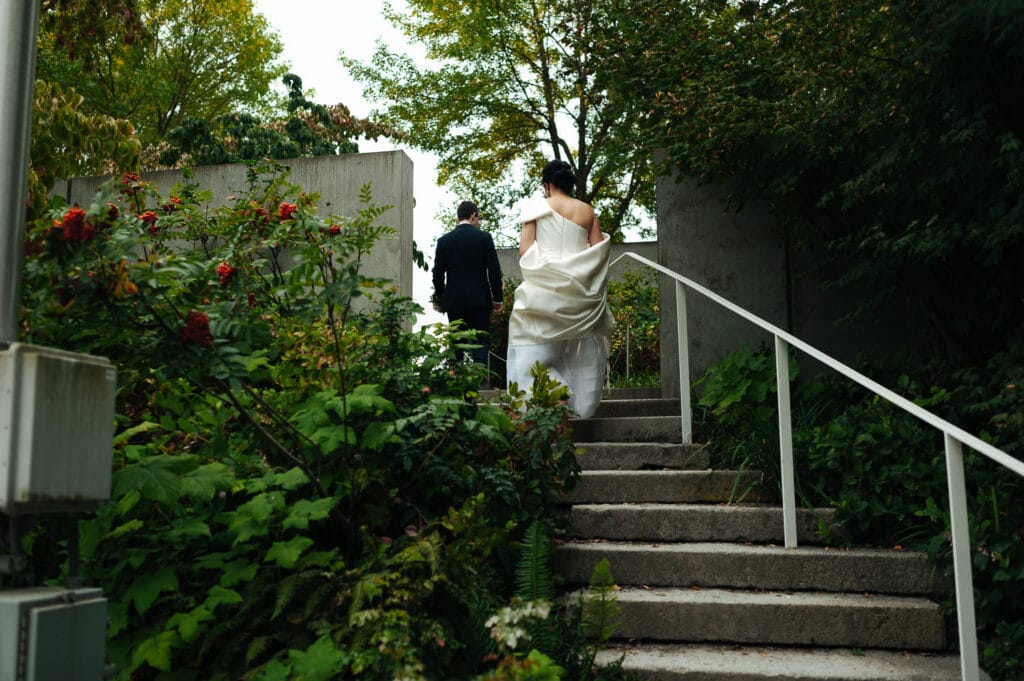 bride and groom walk up stairs during seattle elopement photos