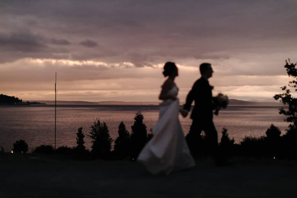 couple runs in pink sunset during seattle elopement photos