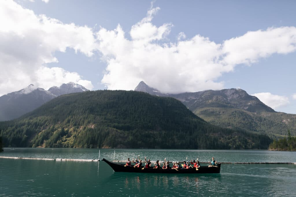guests paddle on diablo lake during north cascades elopement