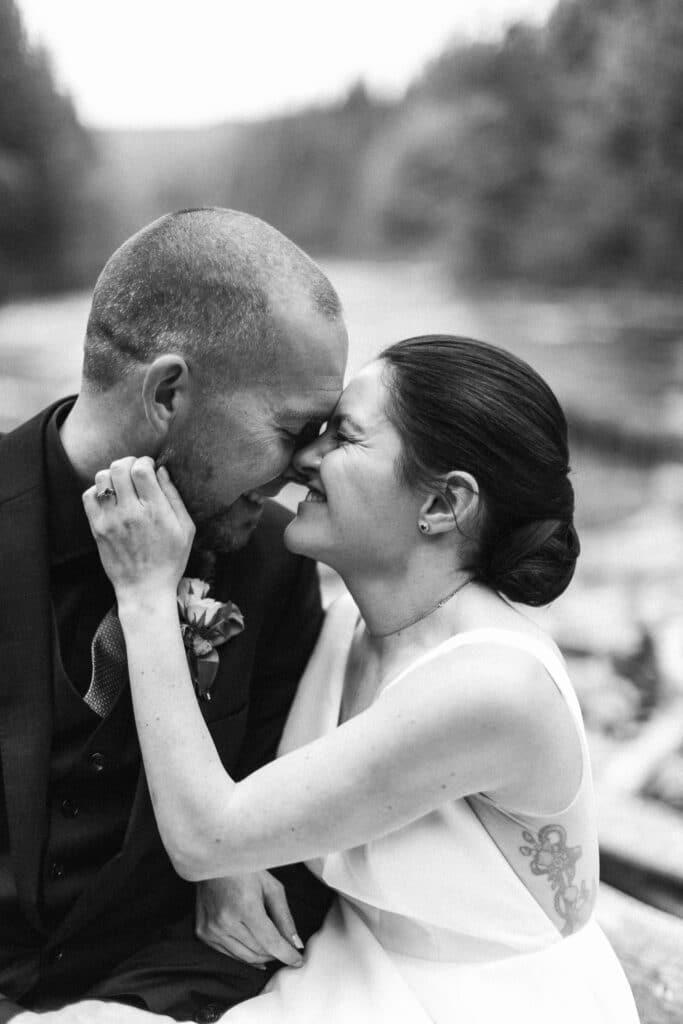 bride and groom smile together