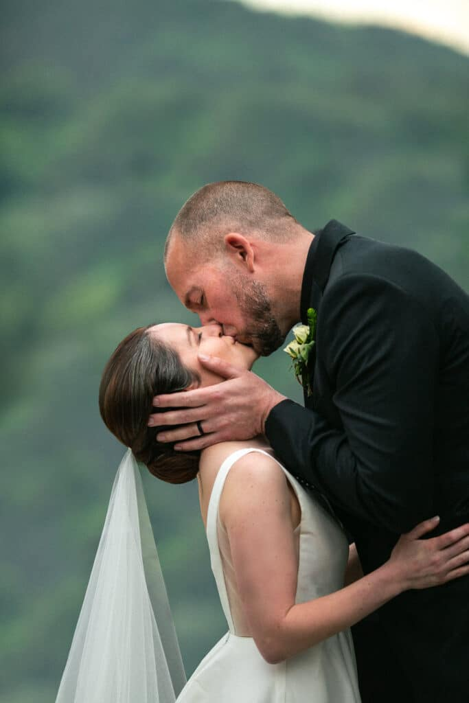 couple kisses during salish lodge wedding